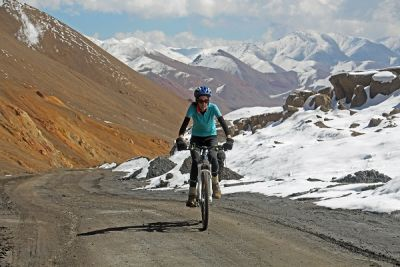 Abby Penlington Cycling on the Tajikistan to Kyrgyzstan   tour with redspokes